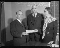 Los Angeles County Supervisor Frank Shaw, George Cuthbert, and Rheba Crawford Splivalo with check, 1933