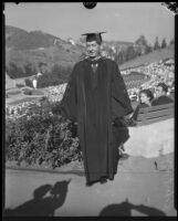 University of California president Robert G. Sproul, in cap and gown, at UCLA graduation ceremony at Hollywood Bowl, Los Angeles, [1932?]