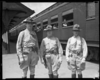 Marine Reserve officers Joseph P. Sproul, John J. Flynn, and O.E. Jensen at train station, 1933