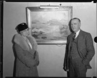 Artist Jack Wilkinson Smith standing in front of painting with Grace Blanchard, [circa 1939]