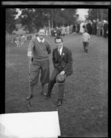 Golfer Macdonald Smith and actor Harold Lloyd on golf course, Los Angeles, 1928