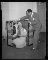 Cartoonist Sidney Smith and wife Kathryn Smith posing with trunk, [Los Angeles?], [1932?]