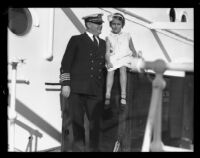 Captain Tom Smith and girl on ship deck, Los Angeles, 1932
