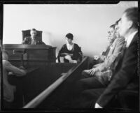 Zelda Smith on witness stand, with Coroner Frank Nance and jury, at arraignment of Harold Wolcott for the Pasadena murder of Helen Bendowski, 1933