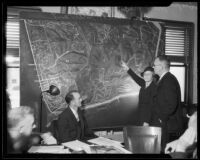 Los Angeles Park Commission president Mabel V. Socha and Chief Deputy District Attorney Robert Stewart with large map of Griffith Park, [Los Angeles?], [1933?]
