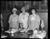 Mabel V. Socha, Agnes Fredericks, and Artie W. Burtnett standing at luncheon table, Los Angeles, 1933