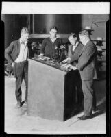 California Institute of Technology Professor Royal W. Sorensen and three students at switch mechanism, [Pasadena], 1929