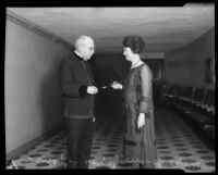 Composer John Philip Sousa receiving gift of baton from Jennie Jones, supervisor of orchestral music in the Los Angeles public schools, Los Angeles, 1926