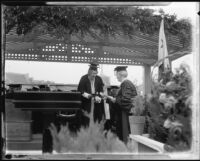 Rufus B. Von Kleinsmid awarding a diploma, University of Southern California graduation, Los Angeles Memorial Coliseum, Los Angeles, 1932