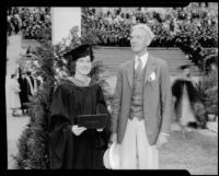 University of Southern California graduation, woman graduate and older man, Los Angeles Memorial Coliseum, Los Angeles, 1934