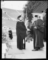Frank C. Touton awarding diploma to his daughter, Harriet Louise Touton, University of Southern California graduation, Los Angeles Memorial Coliseum, Los Angeles, 1934