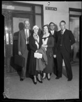 Fraud defendant A.J. Showalter, witnesses, and lawyer outside grand jury room, 1932