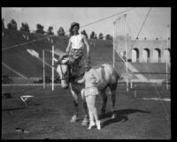 Performers and horse in Shrine Circus, Los Angeles Memorial Coliseum, Los Angeles, 1929