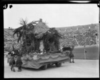 Custer Avenue School students in costume with float depicting California history, Shriners' parade, Los Angeles Memorial Coliseum, Los Angeles, 1925