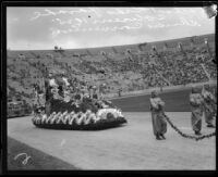 McKinley Junior High School students in costume on float depicting California history, Shriners' parade, Los Angeles Memorial Coliseum, Los Angeles, 1925