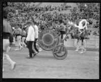 Bass drummer and Abdallah Temple marching band, Shriners' parade, Los Angeles Coliseum, Los Angeles, 1925