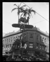 Camel sculpture mounted on wires over Shriners' parade, Los Angeles, 1925