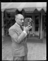 Prince Purachatra Jayakara of Siam with movie camera, 1935
