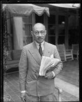 Prince Purachatra Jayakara of Siam with newspaper, 1935