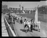 Greek delegation in parade at President's Day Ceremony, Los Angeles Memorial Coliseum, Los Angeles, 1933