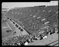 Military vehicles in parade at President's Day Ceremony, Los Angeles Memorial Coliseum, Los Angeles, 1933
