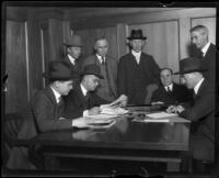 Attorneys, detectives, and others examining papers of murder victim Fay Sudow, 1920