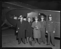 Man holding unidentified device, with Elias Ransome Sutton (2nd from left) and 3 others, 1930