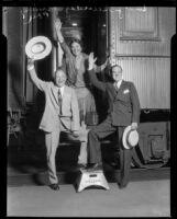 """Evangelist Billy Sunday, wife Helen """"Ma"""" Sunday, and son Paul Sunday near train, [1931?]"""