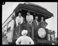 Oscar Solbert and Crown Prince Gustav Adolf of Sweden on a train car platform, Barstow, 1926