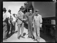 Crown Prince Gustav Adolf of Sweden shaking the hand of the engineer of his train, [Los Angeles?], 1926