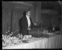Elliott Roosevelt speaking from behind a lectern, circa 1933