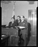 Oil executive James A. Talbot on witness stand with lawyers, 1932