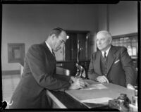 Judge Irvin Taplin, signing paper, and J.C. Hopper, [1929?]