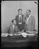 Judge Irvin Taplin, Deputy District Attorney Harry Hunt, and County Clerk L.E. Lampton, at Taplin's desk, [1929?]
