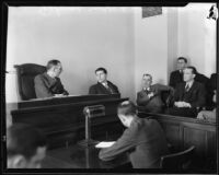 Football player Francis Tappaan on witness stand at inquest, 1933