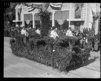 Tournament of Roses float with 4 women in gowns, Pasadena, 1924
