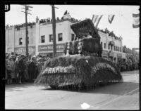 Pasadena Banks float with a woman in a jewelry box in the Tournament of Roses Parade, Pasadena, 1926
