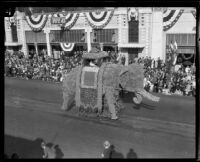 """Elephant"" float with a prince and princess in a howdah in the Tournament of Roses Parade, Pasadena, 1926"
