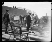 View of the wreckage from a collapsed grandstand on the route of the Tournament of Roses parade, Pasadena, 1926
