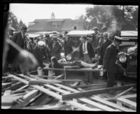 Woman injured by the collapse of a Rose Parade grandstand transported on a litter, Pasadena, 1926