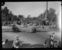 Small float with male driver in white suit and hat in the Tournament of Roses Parade, Pasadena, 1933