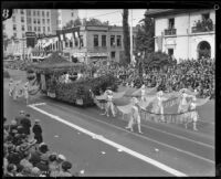Unidentified garden float with 11 winged outwalkers in the Tournament of Roses Parade, Pasadena, 1927