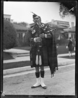 Member of a bagpipe band in Rose Parade, Pasadena, 1928