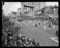 "Elks Lodge marching band and ""Uncle Sam Hat"" float in the Tournament of Roses Parade, Pasadena, 1928"