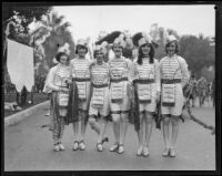 Six young women who hold the banner announcing the start of the Tournament of Roses Parade, Pasadena, 1928