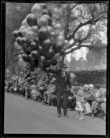 Balloon vendor holding on the route of the Tournament of Roses Parade, Pasadena, 1928