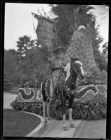 """Blazing the Trail Westward"" float in the Tournament of Roses Parade, Pasadena, 1928"