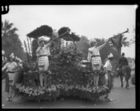 Float with trumpeters and floral eagle in the Tournament of Roses Parade, Pasadena, 1928