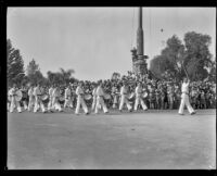 Drummers passing the Goodhue Flagpole at the start of the Tournament of Roses Parade, Pasadena, 1929
