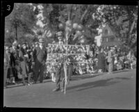 Vendor selling dolls at the Tournament of Roses Parade, Pasadena, 1929
